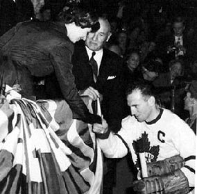 Teeder pays homage to Princess Elizabeth while Conn Smythe looks on, 1951