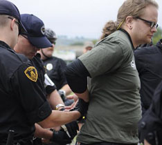 Protesting the G20 in Pittsburgh: One of five Greenpeace activists is handcuffed in Point State Park after being arrested for attempting to hang a banner off the Fort Pitt Bridge, September 23.. Pam Panchak / Post-Gazette.