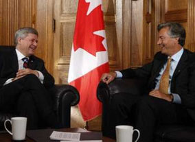 """Canada's Prime Minister Stephen Harper (L) shares a laugh with former Manitoba Premier Gary Doer during a meeting in Harper's office on Parliament Hill in Ottawa August 28, 2009. Conservative Prime Minister Stephen Harper has appointed Doer, a member of the left-leaning New Democratic Party, as Canada's ambassador to the United States."" (REUTERS/Chris Wattie)."