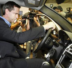 Ontario Premier Dalton McGuinty sits in a GM hydrogen fuel cell vehicle.