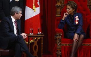 Prime Minister Stephen Harper speaks with Governor-General Michaelle Jean as she waits to deliver the Speech from the Throne in the Senate Chamber on Parliament Hill in Ottawa, Monday Jan.26, 2009. [The Canadian Press].