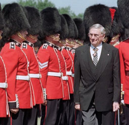 "The late Romeo LeBlanc, Governor General of Canada, 1995–1999, referred to himself in office as a ""head of state"" in 1999. Here he performs his annual inspection of the ceremonial guard at Rideau Hall on June 22, 1999."