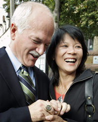 New Democratic Party (NDP) leader Jack Layton and his wife and NDP candidate Olivia Chow show his father's parliamentary pin ring that he wears for good luck after casting their federal election votes in Toronto, October 14, 2008. The late Robert Layton was a Progressive Conservative Member of Parliament in the 1980's. (Reuters).
