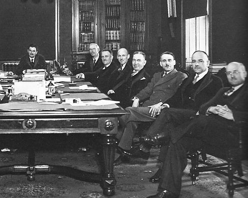 Jack Layton's grandfather, Gilbert Layton (far right), at the Duplessis provincial cabinet table in Quebec. With him are (left to right), Maurice Duplessis, Martin Fisher, Onésime Gagnon, John Bourque, William Tremblay, Joseph Bilodeau, and Thomas Joseph Coonan.