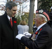 Liberal Leader Michael Ignatieff speaks with 87-year-old veteran Ernie Scale (R) before a wreath-laying ceremony during Remembrance Day services at the Long Branch Cenotaph in Toronto November 11, 2009. REUTERS/ Mike Cassese.