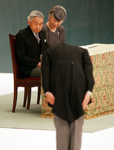 Emperor Akihito and Empress Michiko look on as Japanese Prime Minister Shinzo Abe bows towards them during the memorial service for the war dead of World War II at Nippon Budokan Hall, August 15, 2007, in Tokyo, Japan.