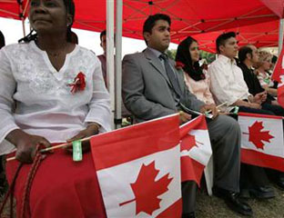 New Canadian citizens at a swearing-in ceremony held at Centennial Park in Etobicoke, Ontario, July 1, 2005  before the present Conservative minority government came to office.  