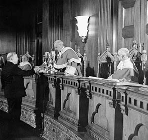 "Chief Justice Thibaudeau Rinfret presenting a citizenship certificate to the Rt. Hon. W.L. Mackenzie King, Prime Minister of Canada, during the first citizenship ceremony to take place following the enactment of the first Canadian Citizenship Act in 1947. Before this Act Canadians had just been ""British subjects."""
