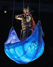 Fiddler Ashley MacIsaac performs in suspended canoe during the opening ceremony of 2010 Winter Olympics in beautiful Vancouver, BC, Friday, February 12. Photograph by: John Mahoney/Canwest News Service.