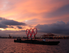 Olympic rings illuminated, on a barge moored off Stanley Park, February 12, 2010. Photograph by: Chris Helgren, Reuters.