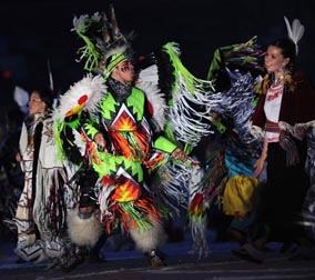 Performers representing diverse aboriginal peoples of Canada dance during the opening ceremony, welcoming guests to home and native land. Photograph by: ADRIAN DENNIS, AFP/Getty Images.