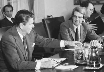 President Ronald Reagan (left) offers youthful budget director David Stockman some jelly beans during a budget meeting in the 1980s. © Bettmann/Corbis.