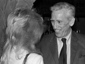 "J.D. Salinger, 63, with actress Elaine Joyce at the Alhambra Dinner Theater in Jacksonville, Florida, 1982. This was their first in-person meeting after a ""romance via telephone and mail."" Ms. Joyce discovered: ""He wasn't a very nice man."" GENE SWEENEY JR./The Times-Union."