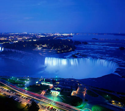 Niagara Falls, Ontario at night — right next door to Niagara Falls, New York. Once upon a time New York was the most populous state of the union. Then California surged ahead, and now even Texas has more people. But it will still be quite a long time before any other Canadian province has more people than Ontario — as Dalton McGuinty keeps trying to remind the rest of Canada.