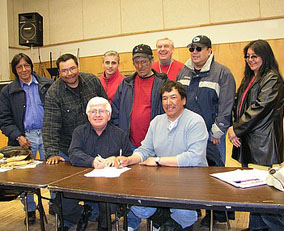 "Signing of a Memorandum of Co-operation between the Ontario government and the Webequie First Nation, May 14, 2004. The memorandum committed ""both parties to enhance communication and understanding that may foster job creation and economic growth in the area."""