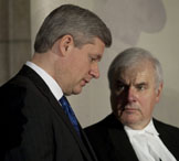 Prime Minister Stephen Harper speaks with Commons Speaker Peter Milliken during a signing ceremony for the Book of Reflection in Ottawa, March 29, 2010. ADRIAN WYLD/THE CANADIAN PRESS.