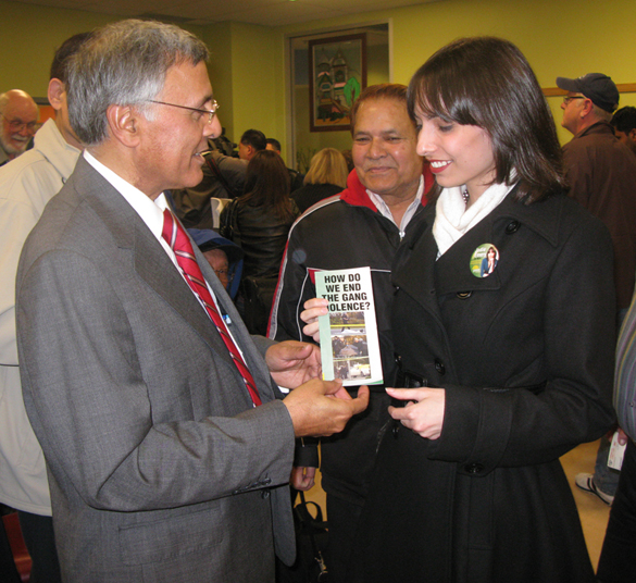 "Federal Liberal Party Member of Parliament for Vancouver South, Ujjal Dosanjh (l), at a meeting on gang violence at South Vancouver Neighbourhood House, March 18, 2009.  He is meeting Jodie Emery, wife of Canada's ""Prince of Pot,"" Marc Emery.  Photo by Sen."