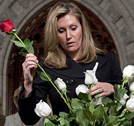 Helena Guergis, minister for status of women, honours the 14 women slain in Montreal in 1989 at a ceremony in the Canadian House of Commons foyer, December 1, 2009. ADRIAN WYLD/THE CANADIAN PRESS.