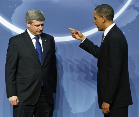 "Prime Minister Stephen Harper met with Barack Obama April 12 at the US president's nuclear security summit in Washington. This photo, taken by Jason Young at  Reuters, ""has sparked a raft of comedic suggested captions."" Our entry: ""Are you a real country or not? Canada won't get anywhere until it has its own elected head of state."""