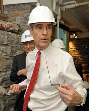 Michael Ignatieff helps repair stone walls at Saint Brigid's Centre for the Arts and Humanities, on St. Patrick Street in Ottawa, April 2009. Supervising the new leader of the Liberal Party of Canada is architect Barry Padolsky on the left. Photo: John W. Macdoanld.