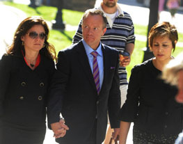 Michael Bryant, wife Susan Abramovitch (l), and lawyer Marie Henin arrive at court on Tuesday, May 25. Colin McConnell/Toronto Star.