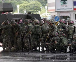 Thai soldiers assemble in front of a barricade made by protesters in Bangkok on Wednesday [May 19]. Ahmad Yusni/European Pressphoto Agency.