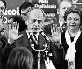 An already somewhat harassed new Québec Premier René Lévesque tries to calm supporters at Parti Québécois rally in Montréal, following his party's first Québec election victory, November 15, 1976.