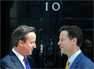Prime Minister David Cameron (l) and Deputy Prime Minister Nick Clegg, outside 10 Downing Street on Wednesday 12 May 2010. Carl De Souza/Agence France-Presse — Getty Images.