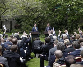 Prime Minister David Cameron (r) and Deputy Prime Minister Nick Clegg hold their first joint news conference in the garden of 10 Downing Street, 12 May 2010. REUTERS/Christopher Furlong/POOL.