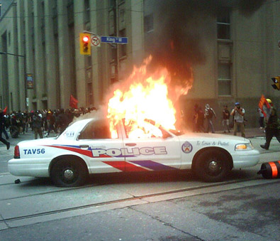 Police car on fire at Bay and King, Toronto financial district.