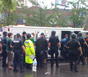 Police detaining protesters and god knows who else on Sunday evening, Queen and Spadina.