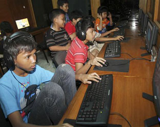 Indonesian youths browse the Internet at an Internet cafe in Jakarta, June 12, 2010. Many Indonesians don't want them watching sex videos, of anyone.