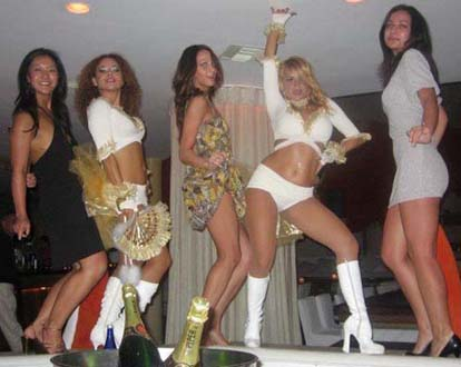 Controversial photograph of Georgian economy minister Vera Kobalia (centre), said by some to be taken at a Vancouver strip club. Photo: Facebook.