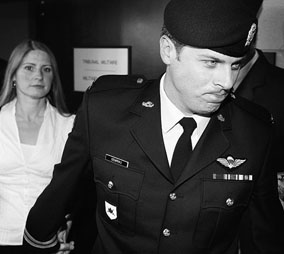 Captain Robert Semrau leaves a court martial in Gatineau, Quebec with his wife, Amelie, on Monday, July 19, 2010. Photograph by Wayne Cuddington, Postmedia News.