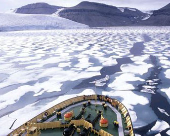Ice breaker makes its way through Northwest Passage. The ice packs are breaking up in season with global warming.