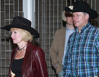 Prime Minister Stephen Harper and his wife Laureen enter Calgary Stampede President's Breakfast on Friday, July 9, 2010. Photo: Ted Rhodes, Calgary Herald.