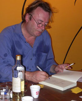 Christopher Hitchens, hard at work, promoting his books.
