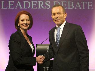 """Julia Gillard and Tony Abbott share a moment before hostilities begin / Picture: Ray Strange."""