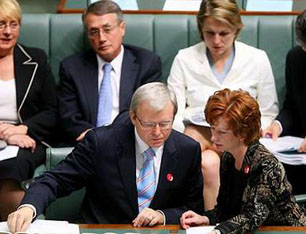 Julia Gillard and the man she finally replaced as prime minister, Kevin Rudd, confer in Australian House of Representatives in an earlier era.
